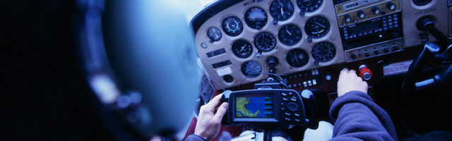 Airplane Pilot at Controls --- Image by © Lucidio Studio Inc./CORBIS
